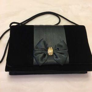 Purse black velvet bow inside pocket snap shut